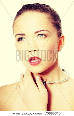 Throat pain concept. Young woman with barbed wire around her throat. Isolated on white background.