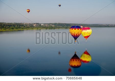 Hot Air Balloons Flying Over Lake.