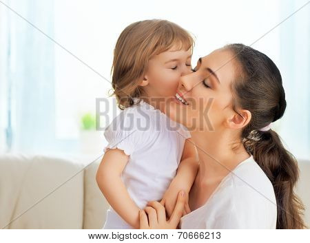 happy mother holding her child