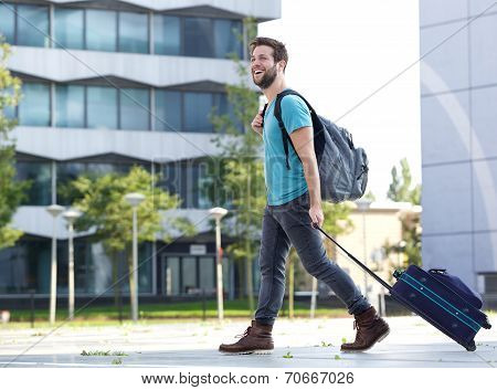 Smiling Young Man Traveling With Suitcase And Bag
