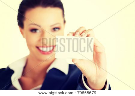 Beautiful smiling businesswoman with businesscard. Isolated on white