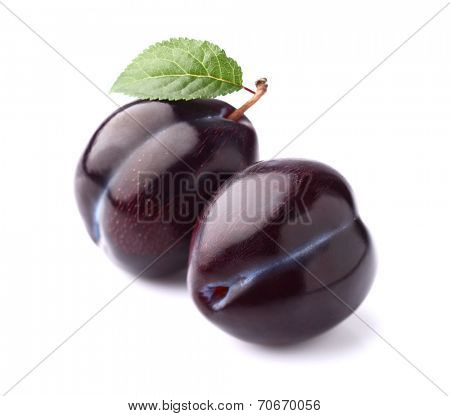 Two plums with leaf