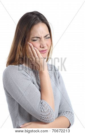 Woman Suffering Toothache With Hand On Face