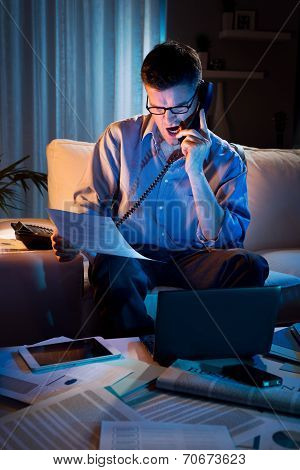 Businessman Working Overtime At Home
