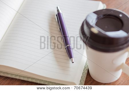 Pen And Notebook With Coffee Cup