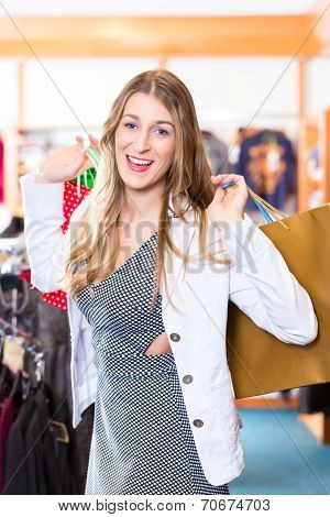 Woman shopping in fashion shop or shop