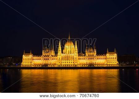 Budapest Parliament Building At Night Illuminated Over The River Danube.
