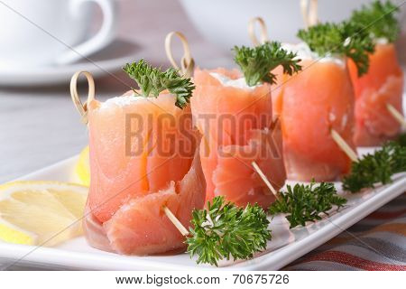 Rolls Of Red Fish With Cream Cheese Close-up Horizontal