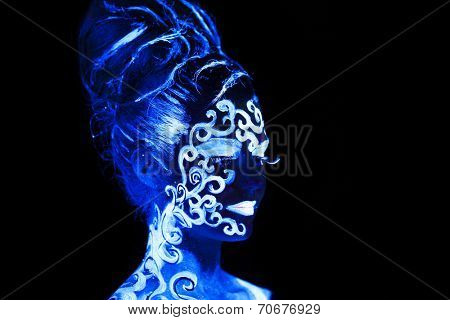 Body art glowing in ultraviolet light,  four elements - air