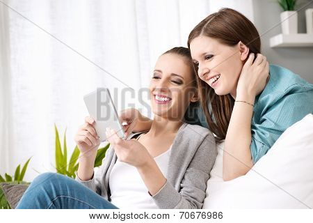 Smiling Girls With Tablet