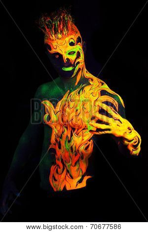 Body art glowing in ultraviolet light -  Fire