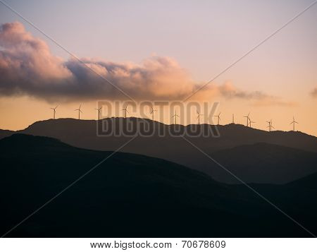 A group of Wind Generators at the top of a hill. Cap Corse, Corsica, France, Europe.
