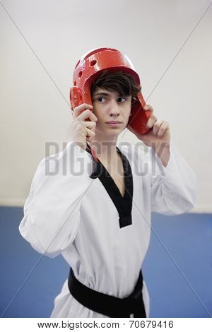 Teenage boy wearing protective headgear in practice session