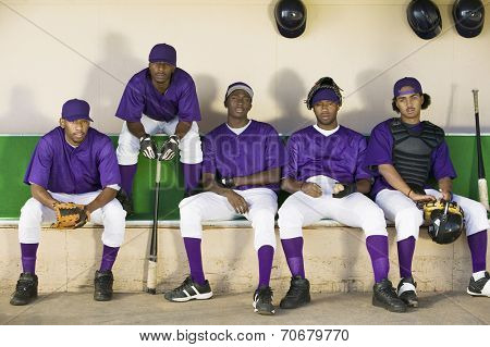 Baseball Team Sitting in Dugout