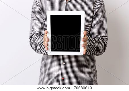 Closeup portrait of a man showing tablet comptuter screen