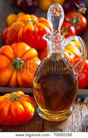 Carafe Of Olive Oil And Ripe Beef Tomatoes