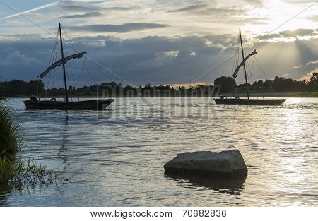 Traditional Boats on Loire with Sunset