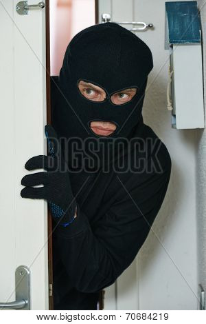 Thief burglar opening door during house breaking penetration