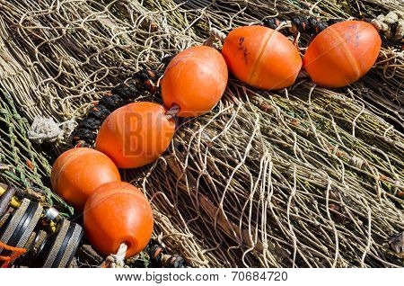 Orange Buoy On Fishingf Nets