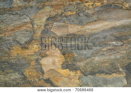flat, multi color foliated slate rock with abstract like landscape pattern