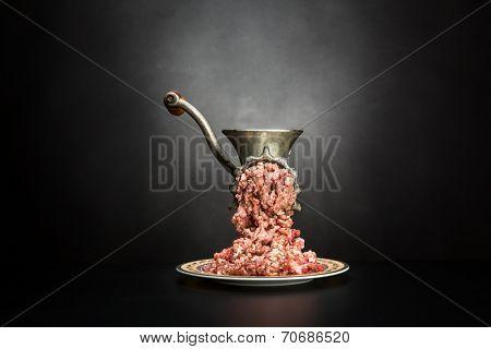 Meat grinder on a black background
