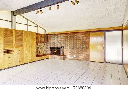 Empty Living Room With Brick Wall Trim And Fireplace