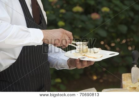 Waiter Serving Cheese