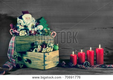 Four Burning Christmas Candles With Santa For Christmas Decoration.