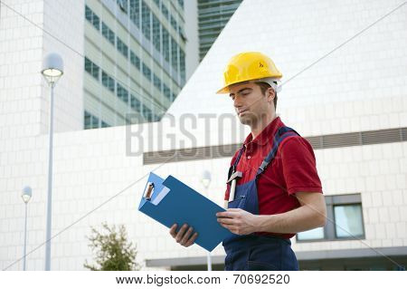 Portrait Of Worker On Workplace