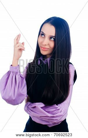 Attractive girl with crossed fingers