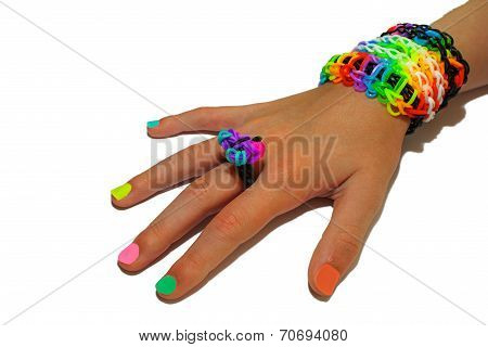 Child's Hand Decorated With Rubber Bands Loom