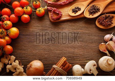 spices and vegetables in anticipation of cooking on a wooden table