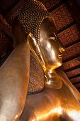 picture of recliner  - Reclining buddha in Wat Pho with half view of Bangkok Thailand - JPG