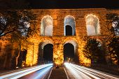 stock photo of aqueduct  - The Valens Aqueduct of Istanbul lit up at night - JPG