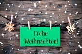 picture of weihnachten  - A Green Label with the German Words Frohe Weihnachten which means Merry Christmas on it Snowy Christmas Background - JPG