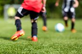 pic of foreground  - Picture of kids soccer training match with shallow depth of field - JPG