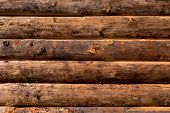 stock photo of log fence  - Wooden wall from logs as a background texture - JPG