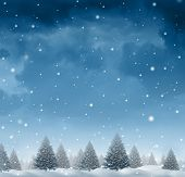 image of seasonal  - Winter snow background concept with a cold blue forest of pine trees on a snowing holiday night sky as a design element with copy space for the Christmas season and festive celebration of for the time of giving - JPG