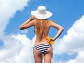 picture of sun tan lotion  - Sun protection and summer body care concept - JPG