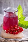 picture of jar jelly  - Red currant jelly in a jar with fresh berries - JPG