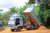 image of dump  - Dump truck in action  - JPG
