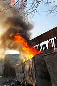 stock photo of dumpster  - Dumpster fire with heavy smoke pollution from garbage