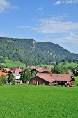 stock photo of bavarian alps  - the popular Village of Kornau in Bavarian Alps near Oberstdorf and Kleinwalsertal Valley, Allgaeu, Bavaria, Germany