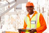 stock photo of substation  - handsome male african electrical engineer in substation - JPG