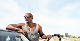 pic of muscle-car  - Handsome young guy leaning on car - JPG