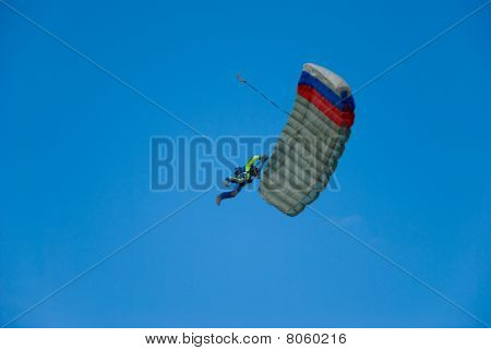 The Parachutist Against The Blue Sky