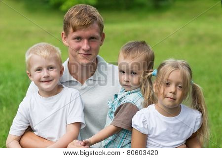 Elder brother with a younger sister and brothers in the park