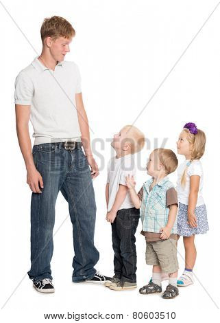 Elder brother with his younger brothers and sister isolated on white
