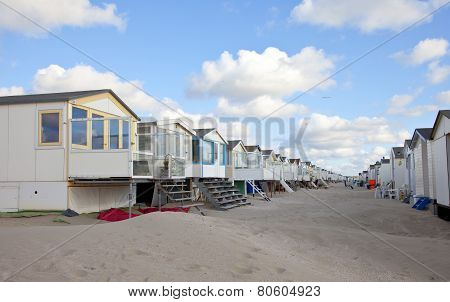Beach Houses On Beach In A Row With Blue Sky