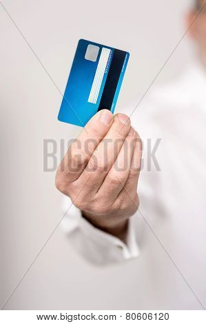 Male Hand Holding A New Cash Card